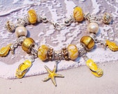 Yellow and White Shell Resin Euro-Style Beaded Charm Bracelet with Ocean Charms