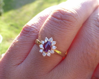 14k Natural Fine Ruby and diamond halo ring
