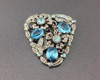 Antique Aquamarine Blue Glass Dress Clip. Silver Pot Metal Art deco clip. Blue faceted Edwardian glass clip. Paste Stones.