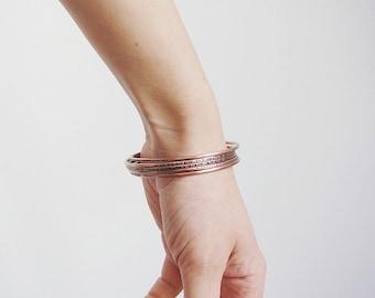 Skinny copper bangle bracelet set. Textured copper bracelet. Boho stacking bangles.
