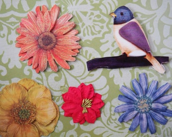 Horizontal 5x7 card covered with decorative paper and three dimensional bird and floral stickers
