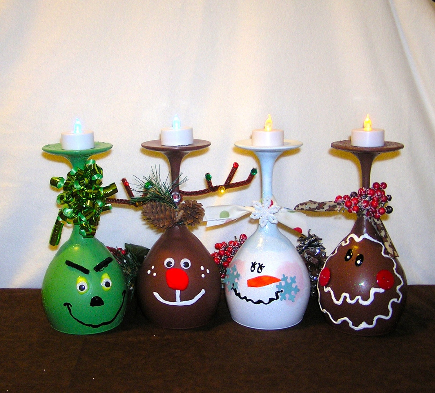 Set of four candle holders grinch wine by bulandscraftboutique for Holiday wine glass crafts