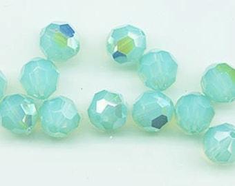 Twelve Swarovski crystals: art 5000 - 8 mm - pacific opal AB