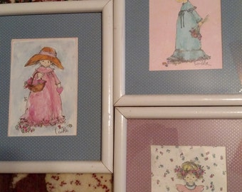 Signed watercolors of little girls.  Vintage set of paintings.