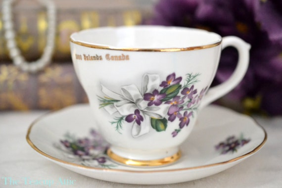 Liverpool Road Teacup And Saucer Set, 1000 Islands Canada Souvenir Tea Cup WIth Purple Pansy Flowers, English Bone China,  ca. 1970