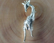 Vintage gold tone giraffe brooch signed Gerry's