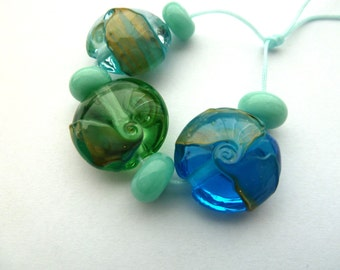 blue and green lampwork sea lentil beads