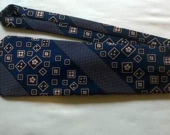 vintage necktie by lynx,as new condition, woven from polyester in blue,pink and black,circa 1970's.