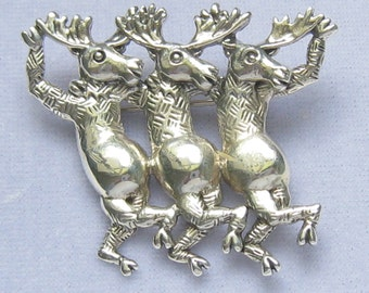Rare CAROL FELLEY Sterling Silver Brooch of 3 Dancing Moose Marked with her Logo.  Dated 90. (1990).