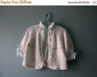ON SALE Vintage handknit white baby sweater /  baby cardigan sweater with blue satin ribbon and pointelle details / baby newborn to 12 month