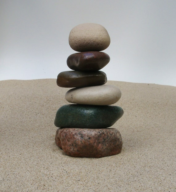 Lake michigan beach stone cairn sculpture stacked