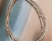Gorgeous Mixed texture Silver Colored Piano Wire Necklace