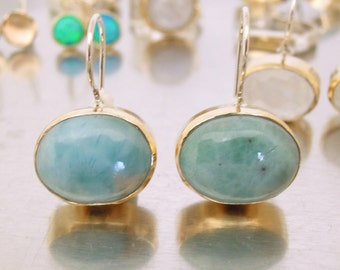 Larimar earrings set in yellow gold oval shaped