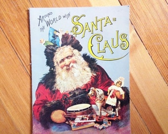 """Vintage Christmas Book / Replica of Antique Xmas Book / """"Around the Word with Santa Claus / Merrimack Publishing Co. / Printed in Hong Kong"""