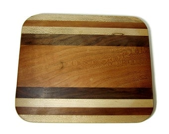Square Shaped Cutting Board made of multi woods, cherry, maple, walnut.  Pretty addition to the kitchen!
