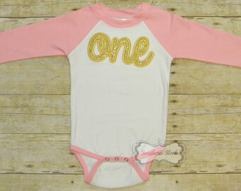 "Gold Glitter ""One"" Embroidered on Pink & White Raglan Bodysuit"