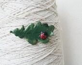 Brooch ladybird beetle on oak leaf