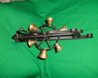One (1), Black Iron and Brass, Door Bells on Rotating Wheel.