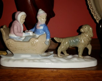 Vintage Meico Inc by Paul Sebastian Dog pulling children in a Sleigh Figurine