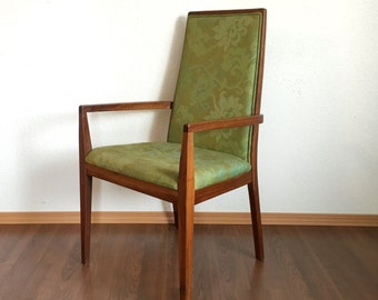 vintage mid century modern chair with green pattern upholstery. vintage seating. retro furniture.