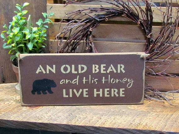 Wooden Welcome Sign An Old Bear And His Honey Live By
