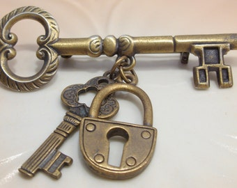 Key and Lock Dangle Brooch in An Antique Brass Finish