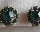 Vintage gold tone screw back earrings with green rhinestones
