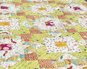 Lap quilt with cute animal prints. A small quitl for kids. Cute quilt throw.