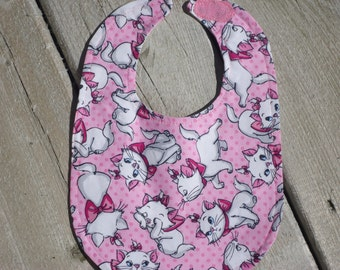 Pretty White Kittens adorning this sweet pink Bib. Ready to ship. Marie Pink Aristocats