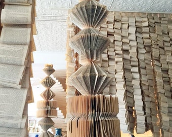 Seven Altered Books for hanging