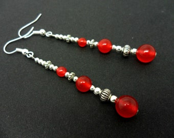 A pair of pretty tibetan silver & red jade  bead long dangly earrings.