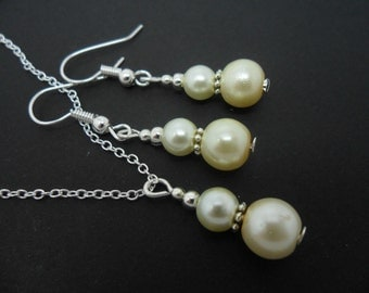 A hand made ivory colour glass  beads   necklace and   earring set.