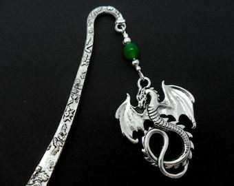 A tibetan silver dragon and green jade bead bookmark.