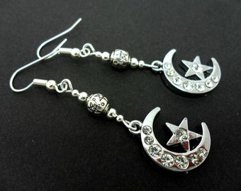 A pair of pretty diamante  silver plated moon and star dangly earrings.