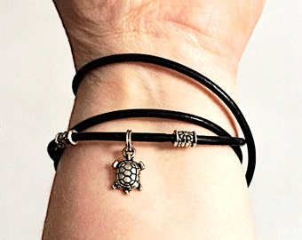 Black leather wrap friendship bracelet with silver turtle charm and daisy spacers