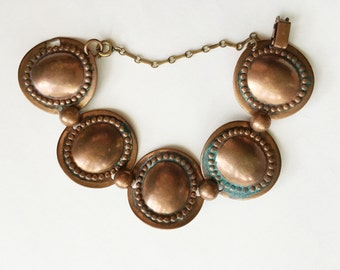 unmarked copper bracelet with round links