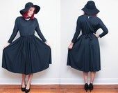 Vintage 70s black KNIT dress // size 8 WITCHY long sleeve dress // 60s dolman sleeve gothic tiewaist dress