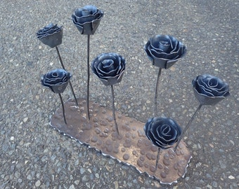 Small Metal Roses and Base Forged by Blacksmith. Iron Roses.