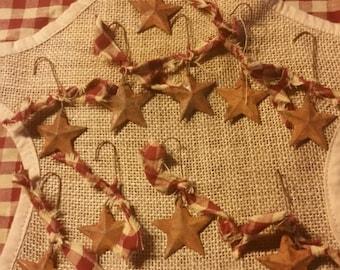 """10 rusty metal star ornaments approx 1.5"""""""