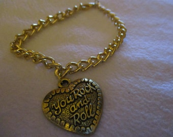 Goldtone 'You Rock and Roll' chain bracelet