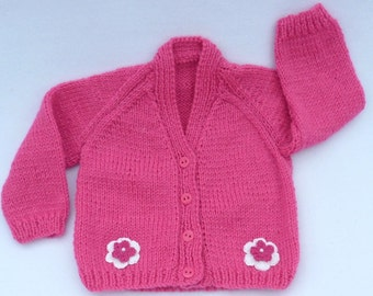 Baby sweater. Baby girl hand knitted raspberry pink baby cardigan to fit 3 to 6 months