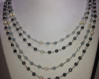 Beautiful wire wrapped necklace with faceted cloudy quartz beads.