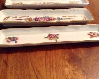 Three China olive or trinket dishes