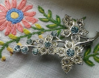Vintage brooch with white and blue stones