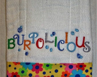 """Diaper burp cloth embroidered with """"Burpolicious"""" and edged with a 100% cotton flower print."""