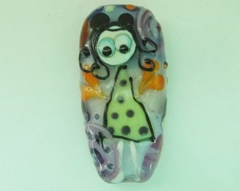 Handmade lampwork bead with a little girl.