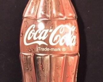 Coca Cola bottle shaped tin