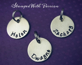 silver name charm , disc hand stamped with a name or date. Personalized name charm. Customized charm