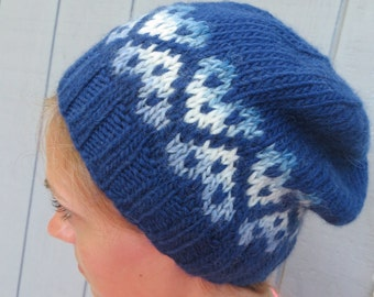 Handknit navy blue hat with heart mofit