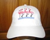 Four Flamingos on a White...
